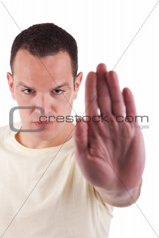 man with his hand raised in signal to stop