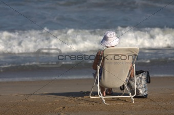 old lady sitting on a chair