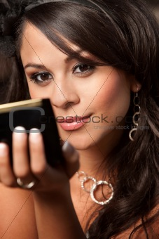 Beautiful Latina Woman with Compact