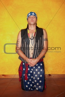 Kneeling Native American man
