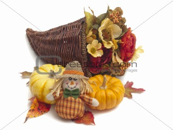 Cornucopia of flowers with pumpkins and scarecrow
