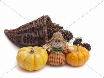 Cornucopia with cones, pumpkins, and scarecrow doll