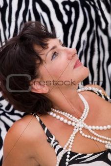 beautiful woman on a zebra like background