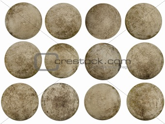 12 worn concrete spheres resembling planets
