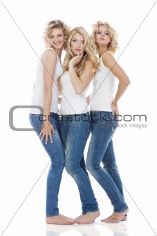 three young women in casual clothing standing - isolated on white