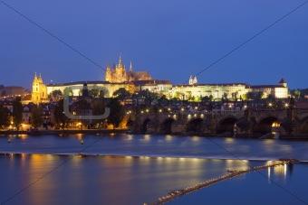 czech republic, prague - charles bridge and hradcany castle at dusk