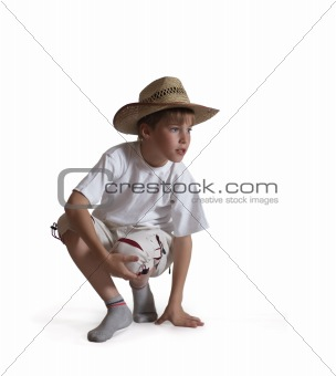 Sitting boy straw hat on white background