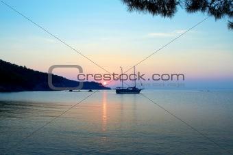 Alone ship at sunset