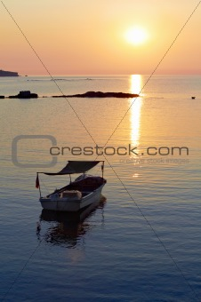 Alone boat at sunset
