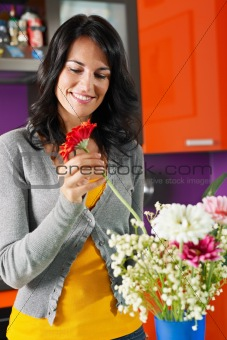 woman arranging flowers in pot
