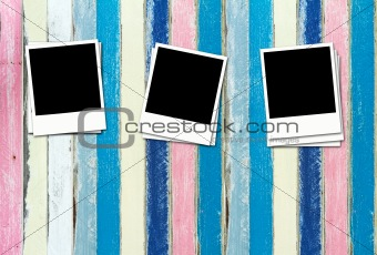 Blank Photos on pastel painting wood background