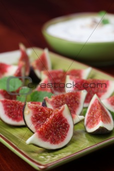 Black mission fig appetizers with nut and honey cheese