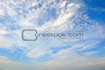 Fleecy clouds on blue sky