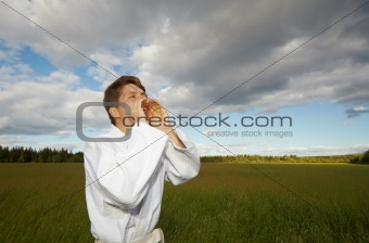 A man shouting into field
