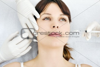 woman receiving an injection of botox from a doctor