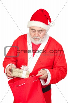 Santa Claus getting a gift from his sack