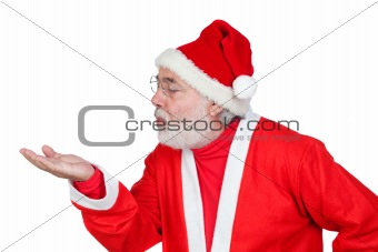 Santa Claus magically blowing in the palm of his hand