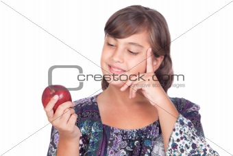 Adorable preteen girl with a apple thinking