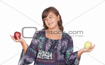 Adorable preteen girl with two different apples