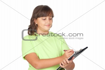 Adorable preteen girl writing on clipboard