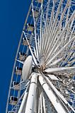 Large White Ferris Wheel with Enclosed Cars