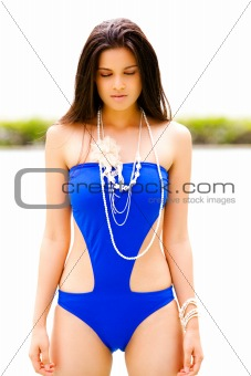 Attractive Young Woman in a Blue Swimsuit
