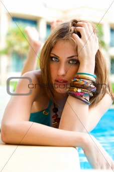 Attractive Young Woman Poolside