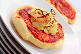 Simple small pizza (pizzette) with onion
