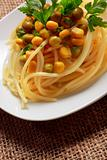 Spaghetti with vegetables and parsley