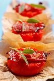 Fried tomato halves with bacon and sage