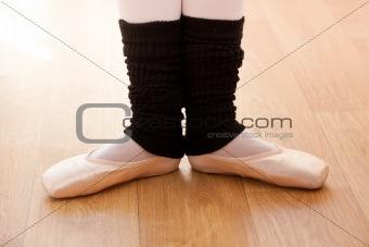 Close-up of the feet of a caucasian ballerina exercising