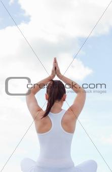 Caucasian woman practising yoga