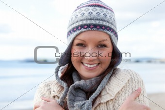 Beautiful young woman is cold and wearing a hat