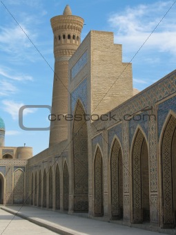 A number of arches and a minaret.