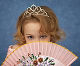 Portrait of young girl with Oriental fan