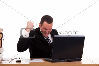 businessman in front of the computer, arm raised and happy, isolated on white background. Studio shot.