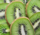 fresh tasty slices of kiwi background 