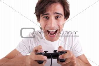 Handsome man, playing with gamepad, isolated on white background. Studio shot