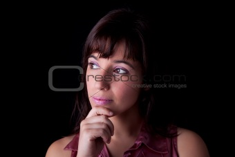 thoughtful and beautiful woman, remember something , isolated on black background. Studio shot.