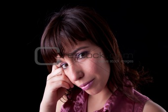 Sad women isolated on black background. Studio shot.