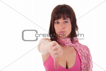 Young pretty women with thumb down, isolated on white background. Studio shot.