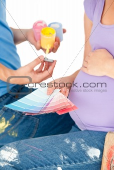 Pregnant woman and her husband choosing samples