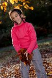 Beautiful Mixed Race African American Girl Playing With Fall Leaves