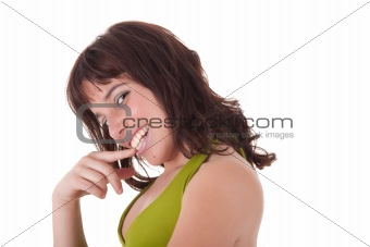 Beautiful young woman touching lips, isolated on white background. Studio shot