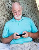 Senior Man Texting