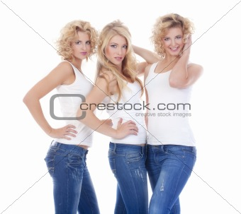 three young female models in casual clothing standing - isolated on white
