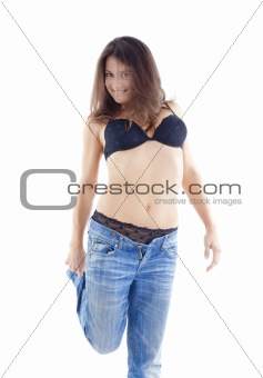 beautiful woman in black bra and blue jeans - isolated on white