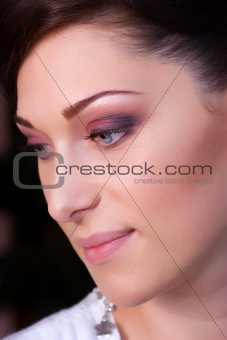 closeup brunette young lady prepared by makeup artist