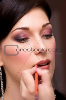 closeup brunette young lady get ready for the event by makeup ar