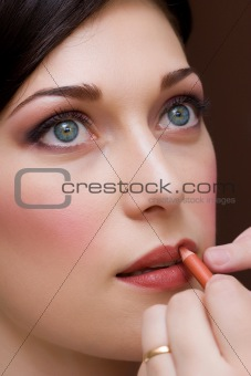 beautiful brunette young lady closeup prepared by makeup artist